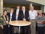Chris Freeman, John Ainley and a group of conference attendees